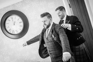 Best man helping groom put his jacket on at a South Shields Wedding