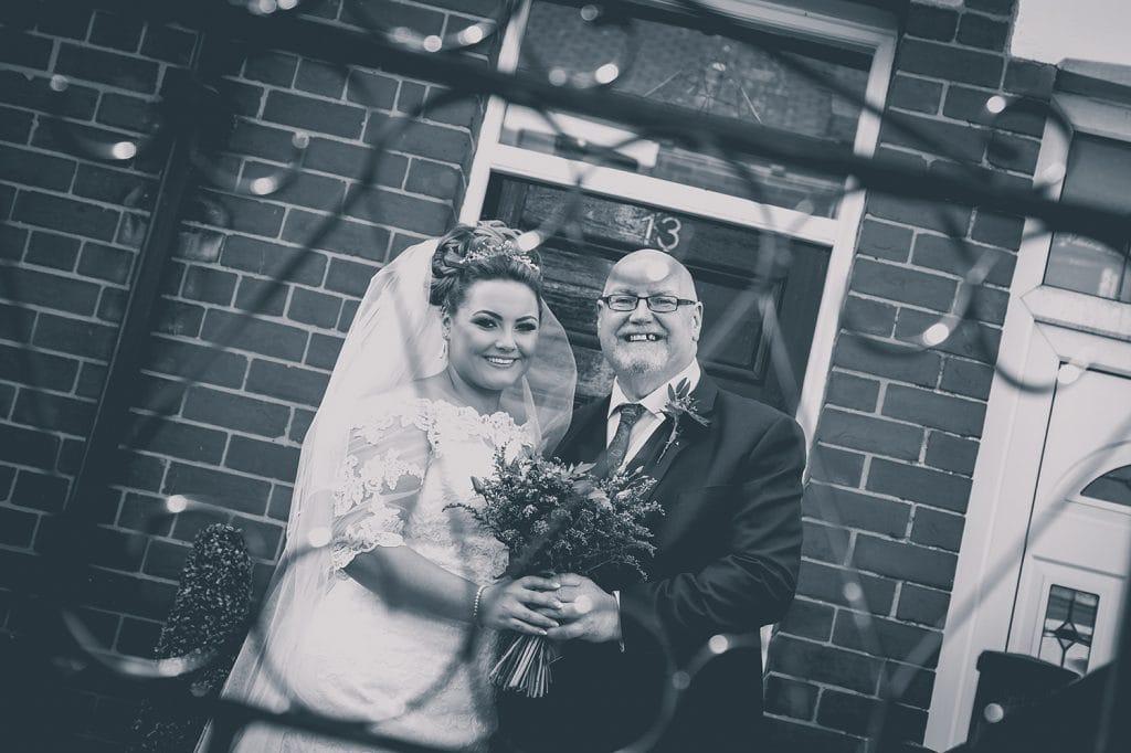 Bride & her dad viewed through their garden gate at a South Shields Wedding