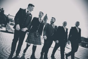 Groomsmen walking to meet guests at South Shields Town Hall