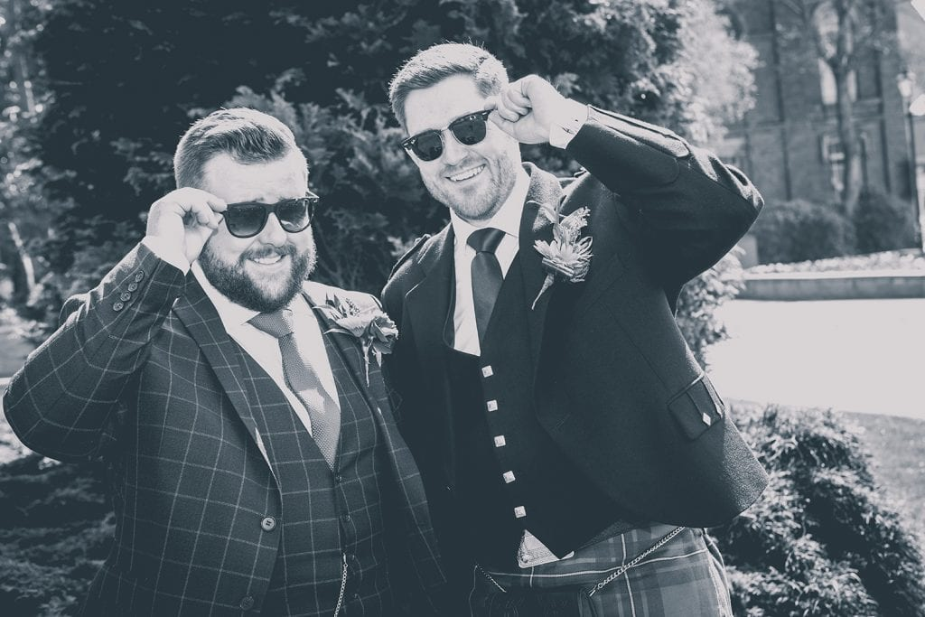 Groom and his best man wearing shades