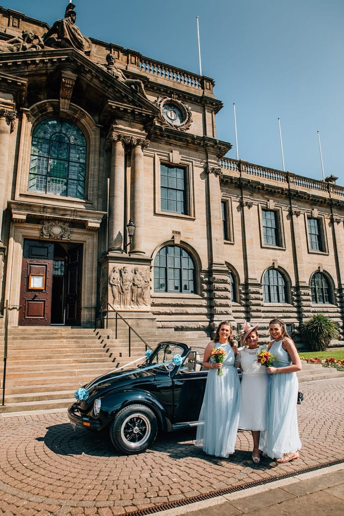 Bridesmaids outside of South Shields Town Hall with their VW Beetle Convertable