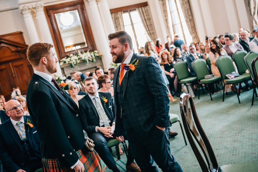 Groom talking to bestman in The Reception Room