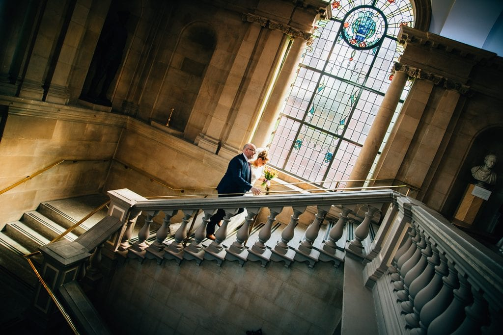 The bride & her dad walking up South Shields Town Hall staircase