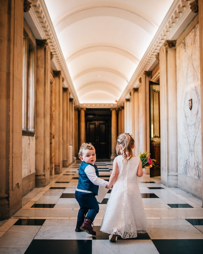 Flower girl & page boy walking through South Shields Town Hall