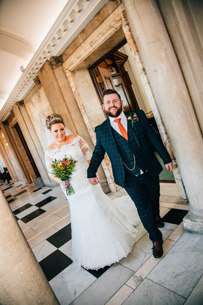 Bride & Groom walking out of the reception room at South Shields Town Hall