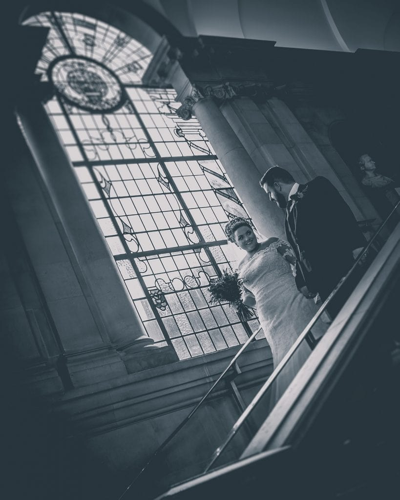 Bride & Groom walking down the South Shields Town Hall Staircase