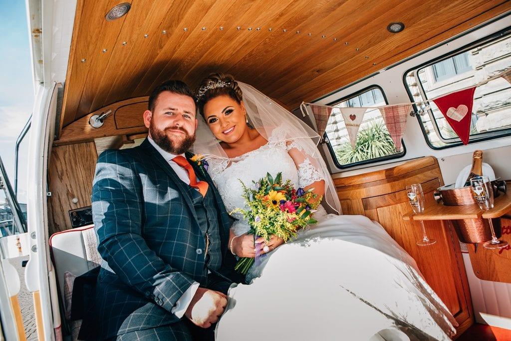 Jame & Sophie sitting in their VW Camper Van