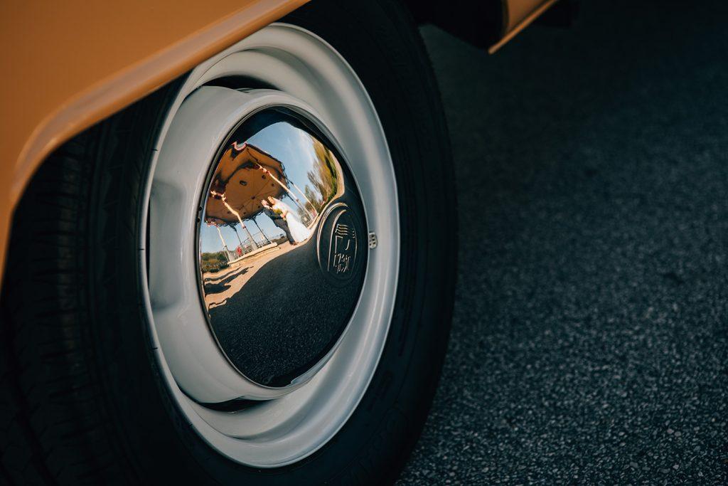The Bride & Groom reflected in their VW Camper Vans Hub cap