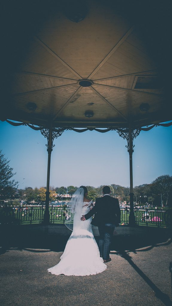 Sophie & James walking through the Bandstand At Marine Park in South Shields