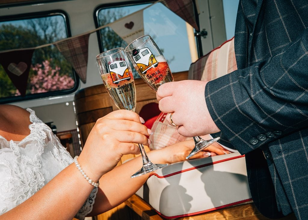 Close up of personalised VW Camper Van champagne glasses