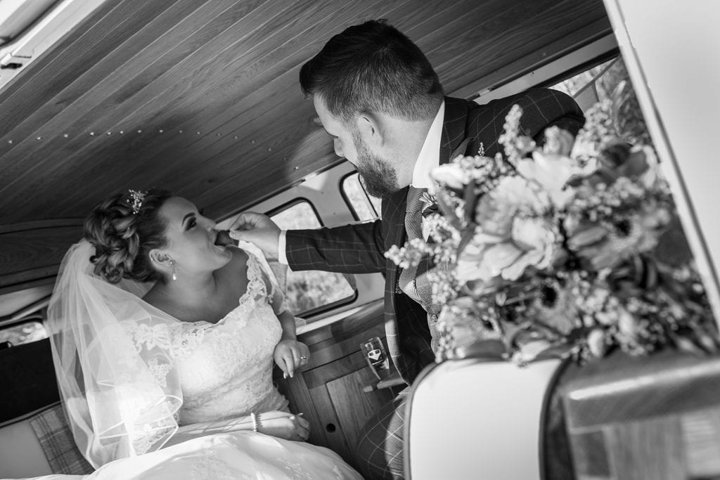 Groom feeding bride a strawberry
