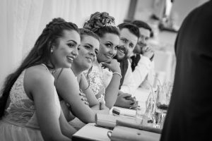 Wedding party laughing at speeches