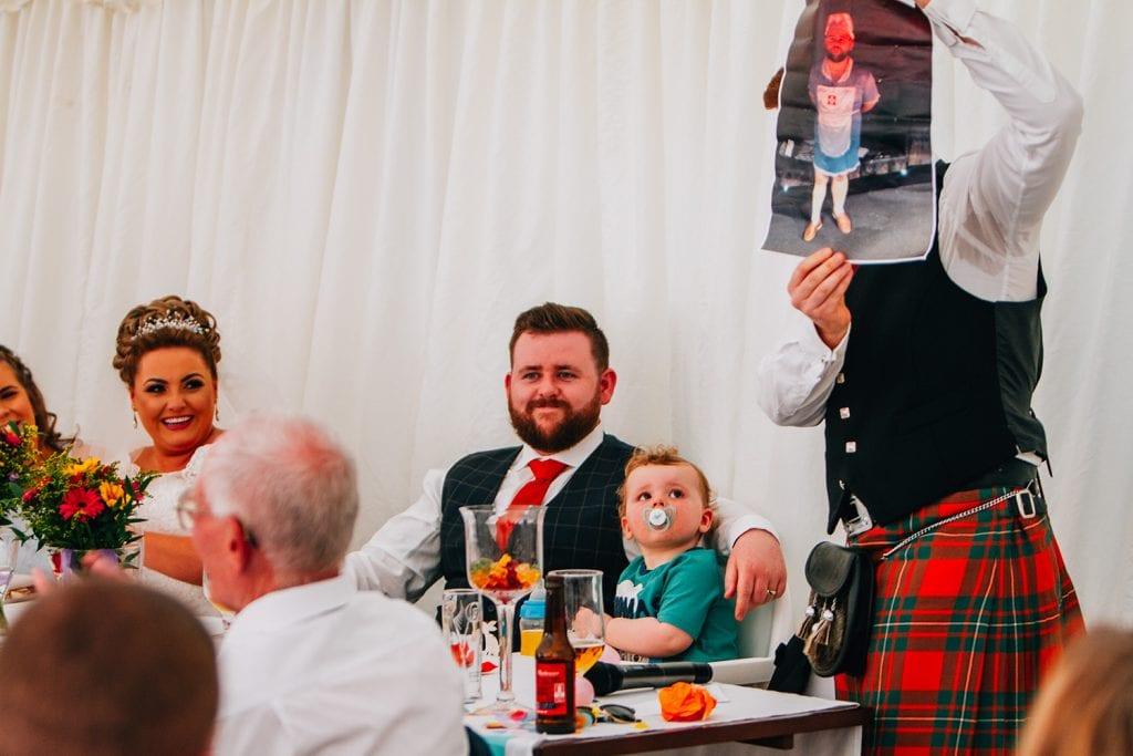 Best man embarrassing the groom