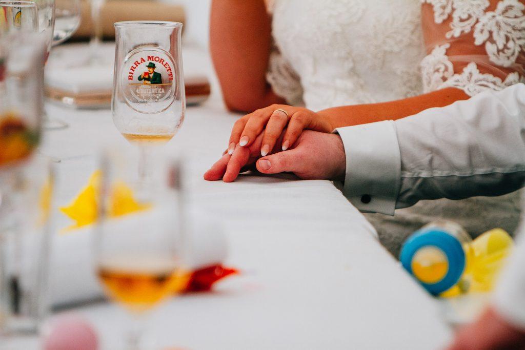 Bride holding groom hand