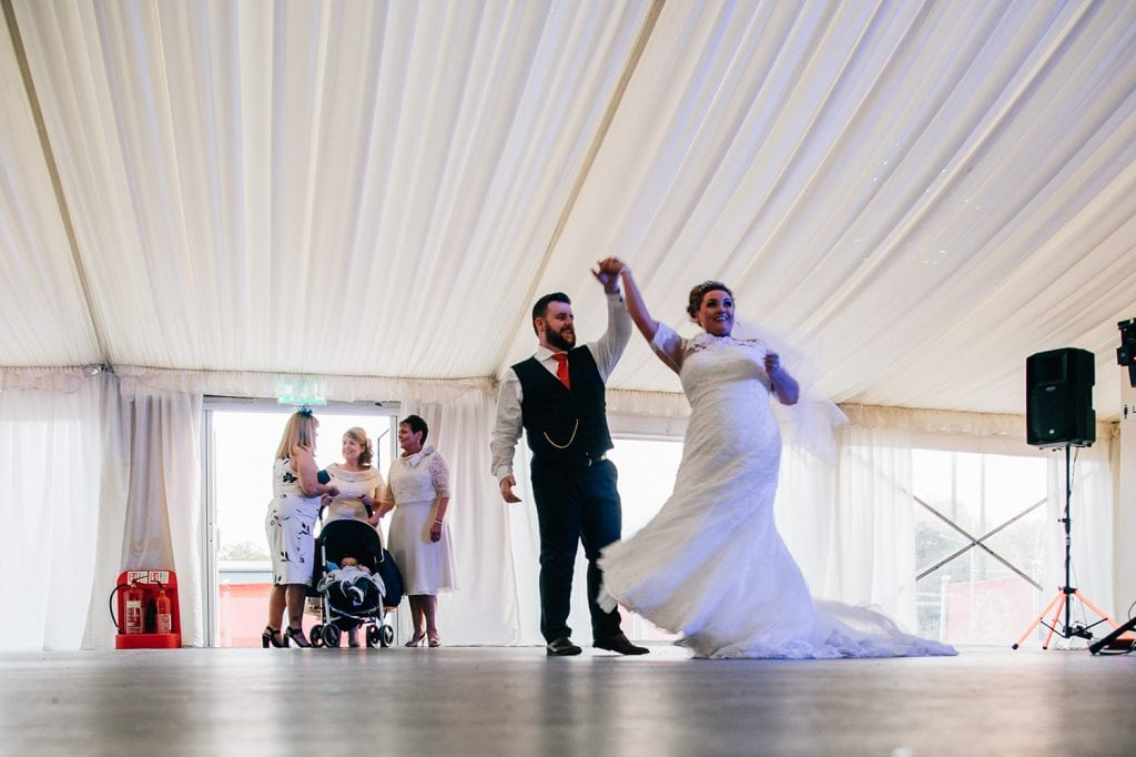 Bride & Groom performing their first dance Guests relaxing in the sun at South Shields Football Club