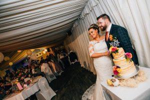 Sophie & James cutting their wedding cake at South Shields Football Club