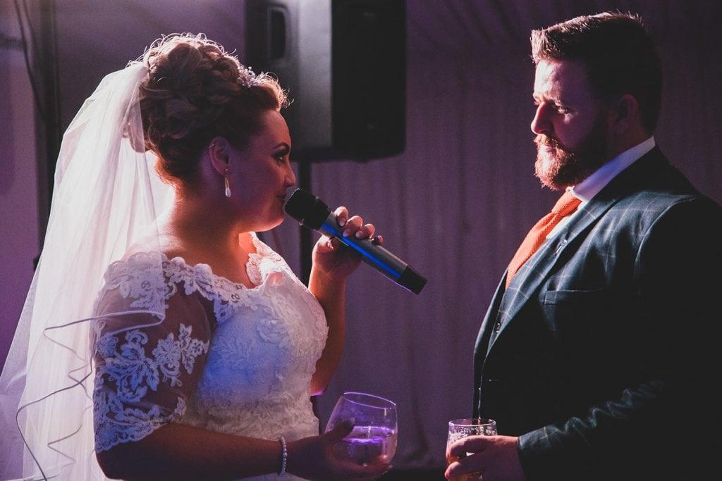 Bride singing karaoke at South Shields Football Club