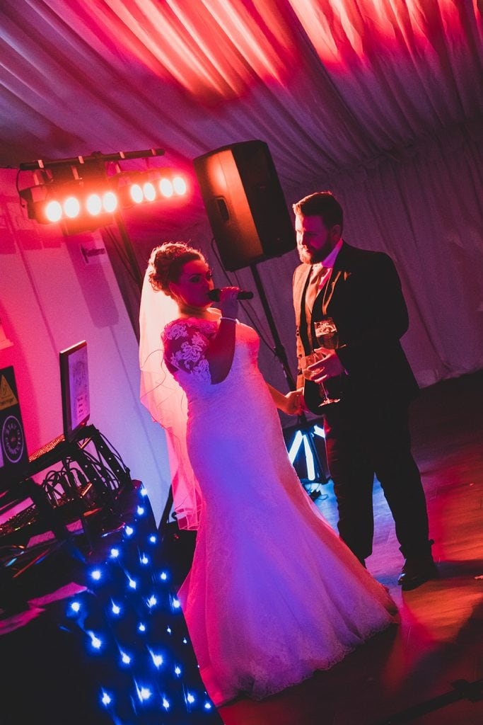 Bride singing to the groom at South Shields Football Club