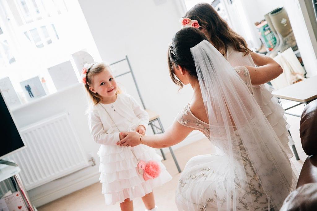 Bride hugging her flowergirls in Ashington