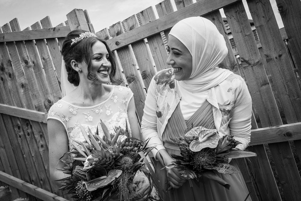 Bride laughing with one of her bridesmaids