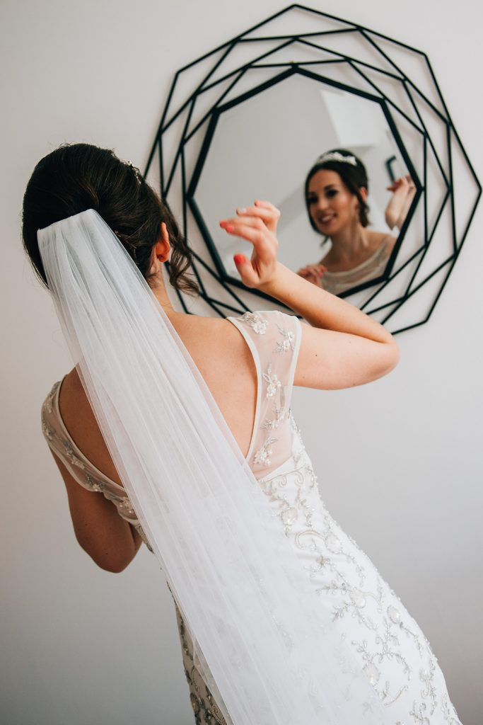 Bride checking her hair in the mirror