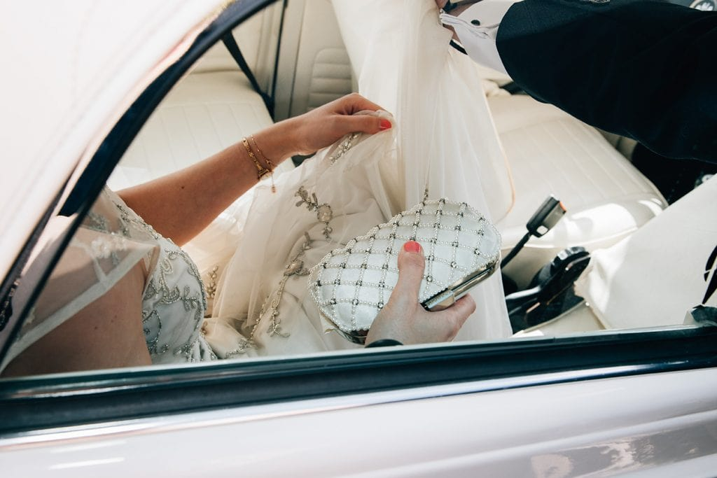 Bride getting comfortable in her White VW Beetle