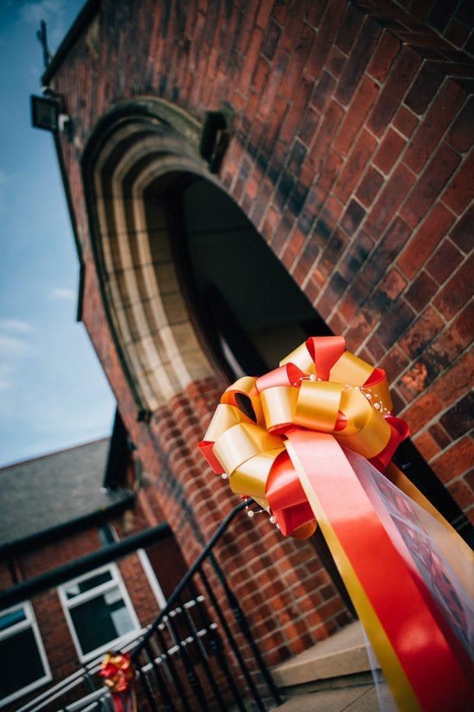 Ribbon decorations outside St Aidan's RC Church in Ashington