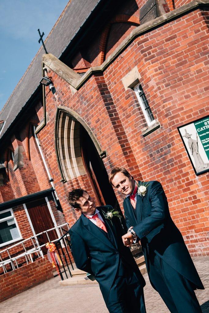 Groomsmen waiting for groom at St Aidan's RC Church in Ashington