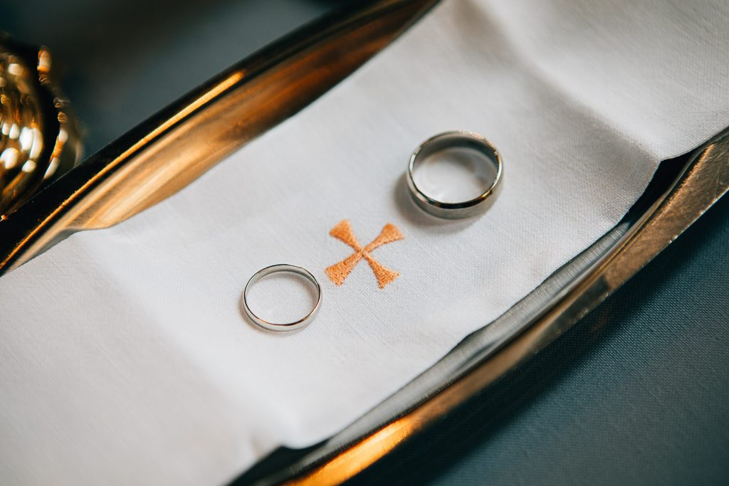 Wedding rings on an alter plate at St Aidan's RC Church in Ashington