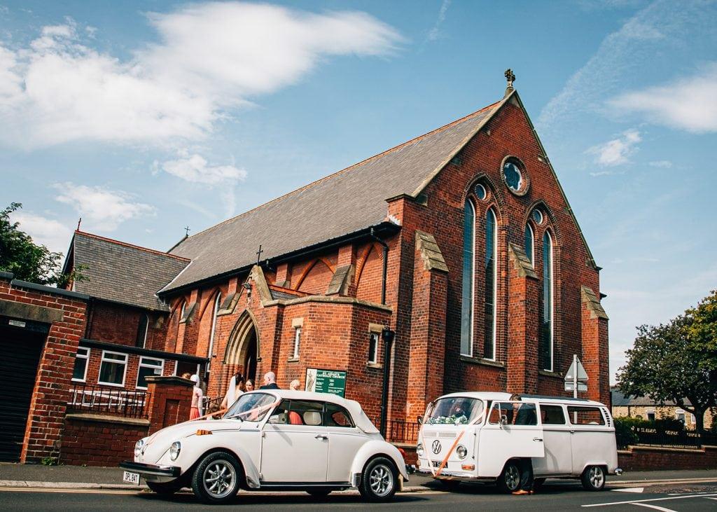 White VW Campervan & Beetle at St Aidan's RC Church in Ashington