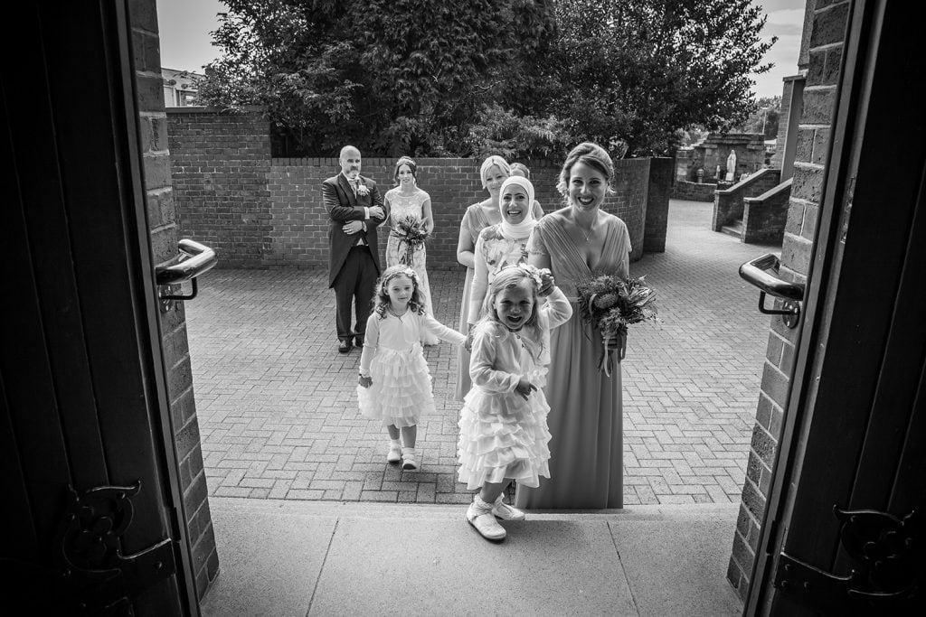 Bridesmaids waiting to enter St Aidan's RC Church in Ashington