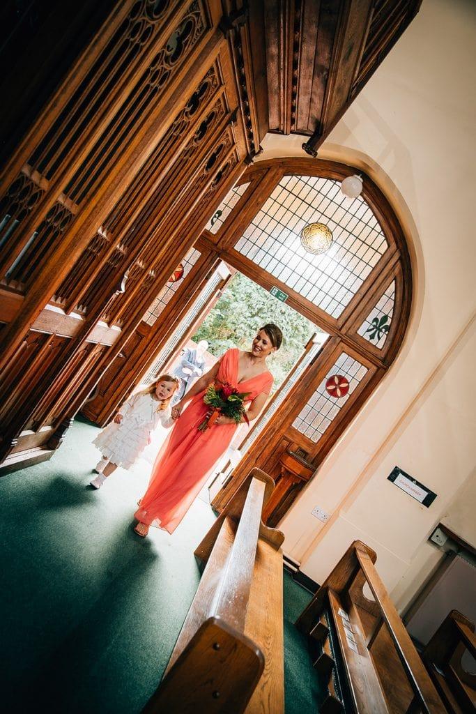 Bridesmaids entering St Aidan's RC Church in Ashington