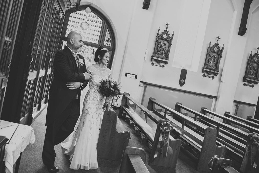 Bride & her brother walking down the aisle in St Aidan's RC Church in Ashington
