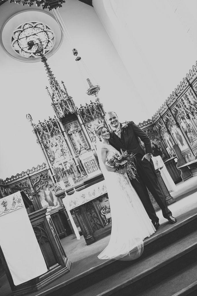 The bride & groom on the alter of St Aidan's RC Church in Ashington