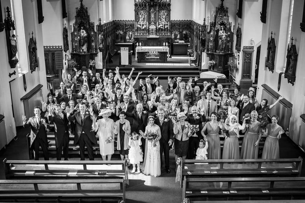 Wedding guests cheering in St Aidan's RC Church in Ashington