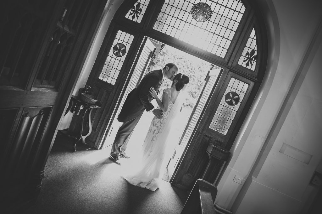 mary & Alex kissing in the doorway of St Aidan's RC Church in Ashington
