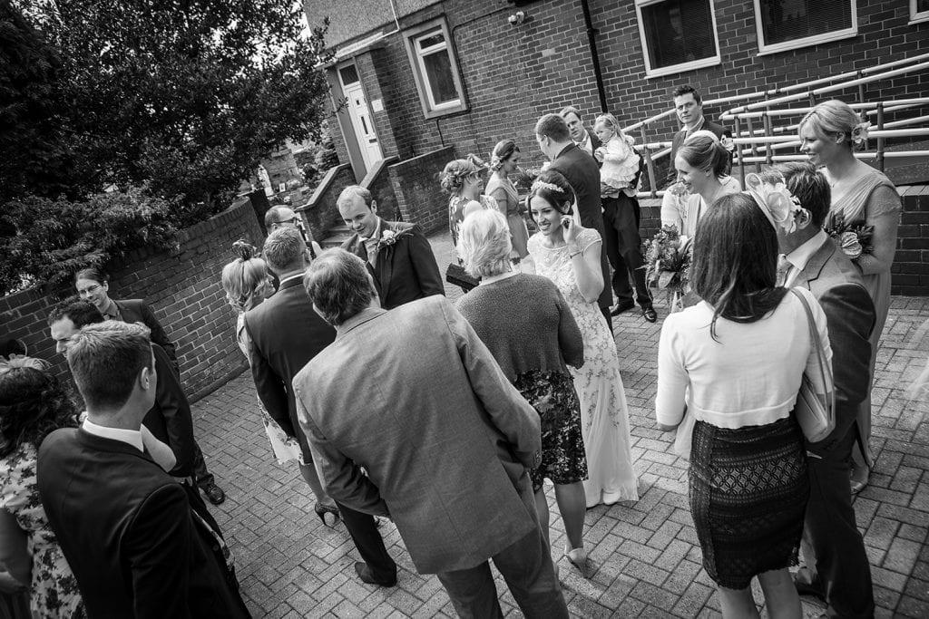 Guests mingling outside St Aidan's RC Church in Ashington