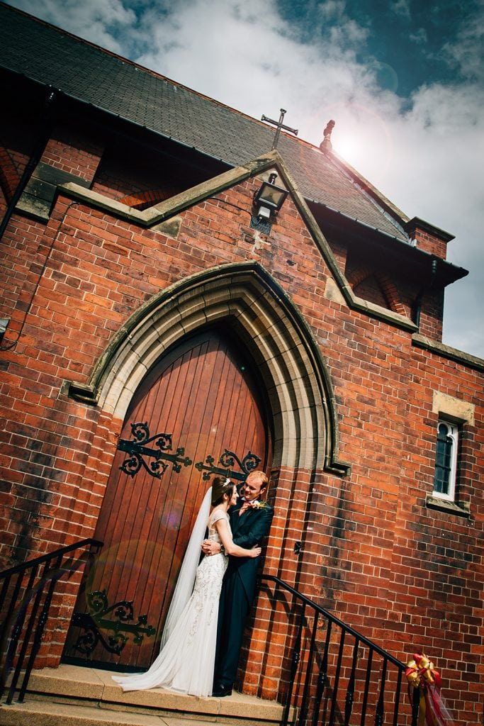 Alex & Mary in the doorway of St Aidan's RC Church in Ashington
