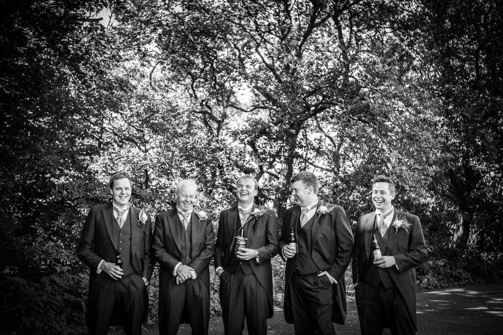 Groomsmen laughing in the grounds of Beamish Park Hotel