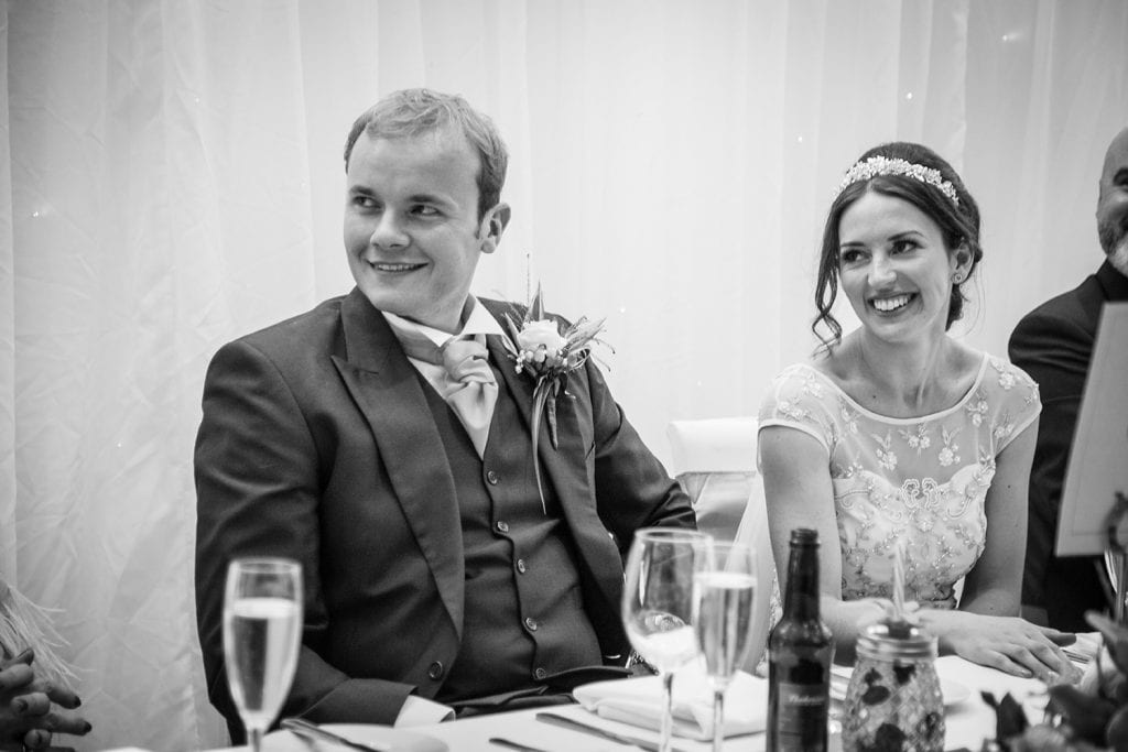 Bride & Groom smiling on the top table at Beamish Park Hotel