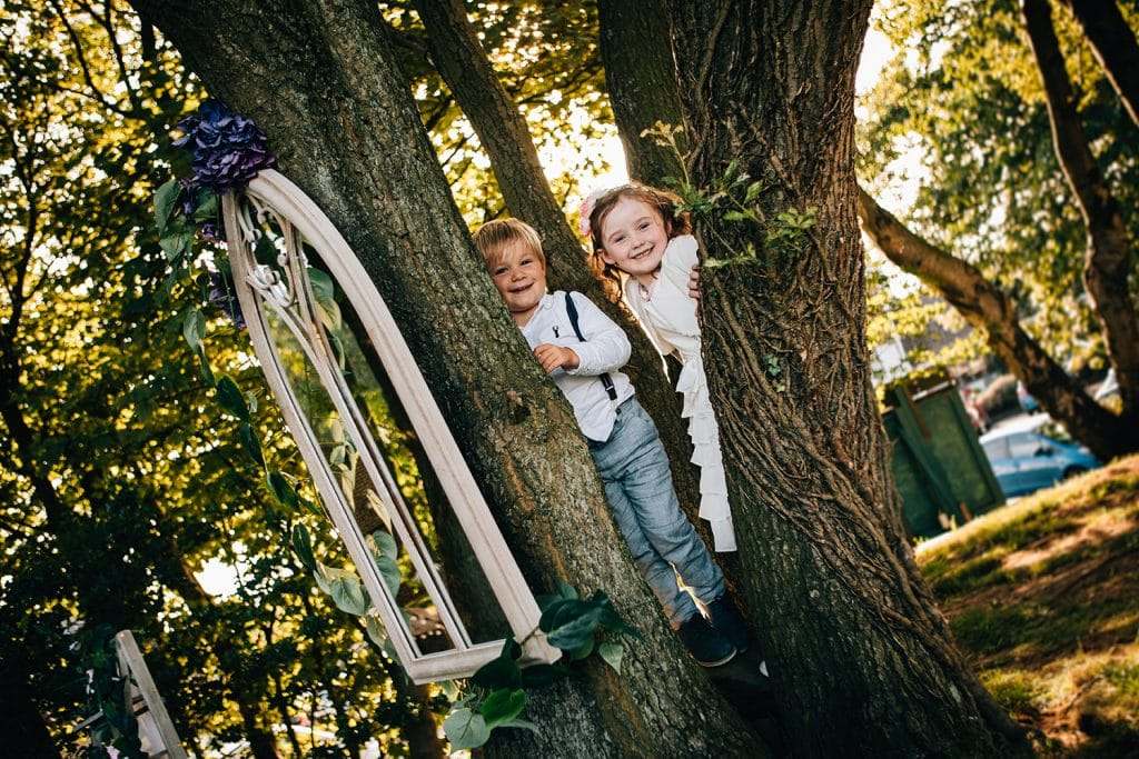 Pageboy & Flowergirl playing in a tree at Beamish Park Hotel