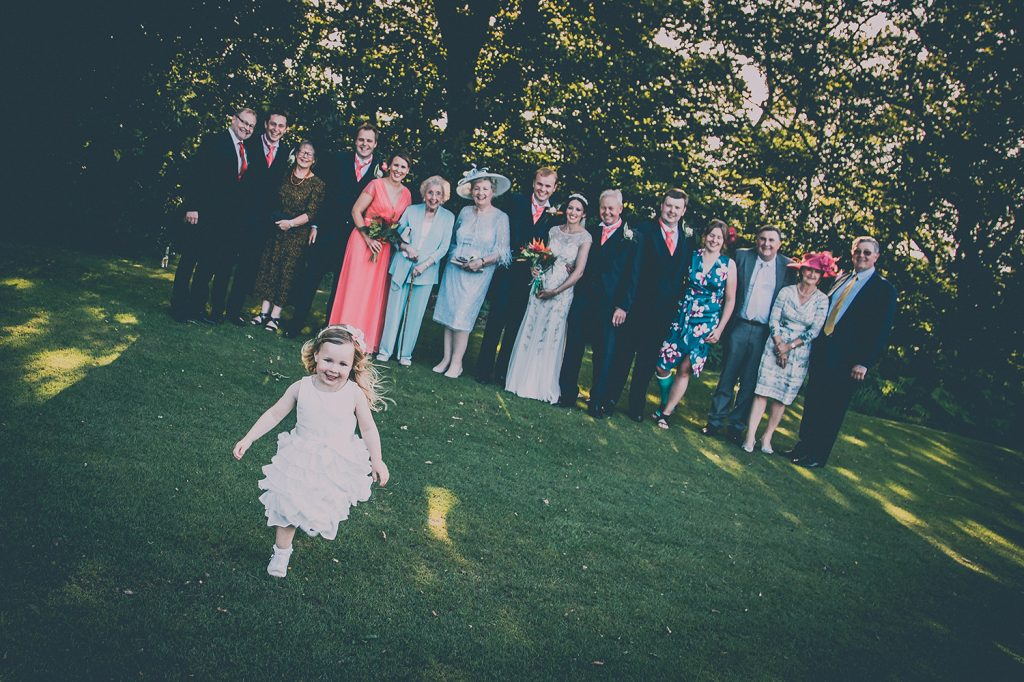 Flowergirl running away from family photo at Beamish Park Hotel