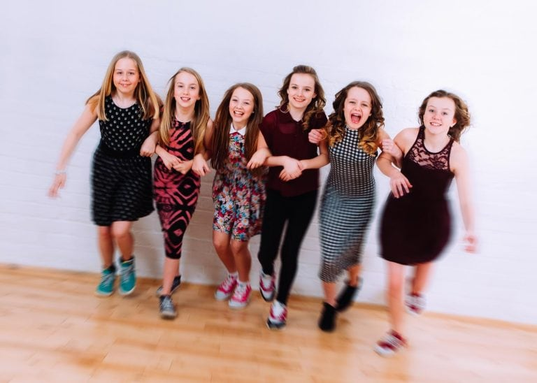 A froup of friends running at the camera after a pamper party at Halo Photography