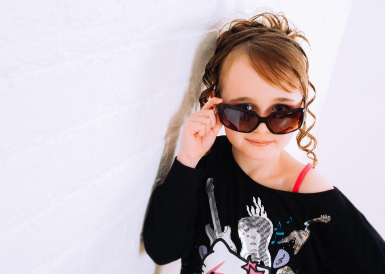 Girl wearing sunglasses at a Halo Photography pamper party