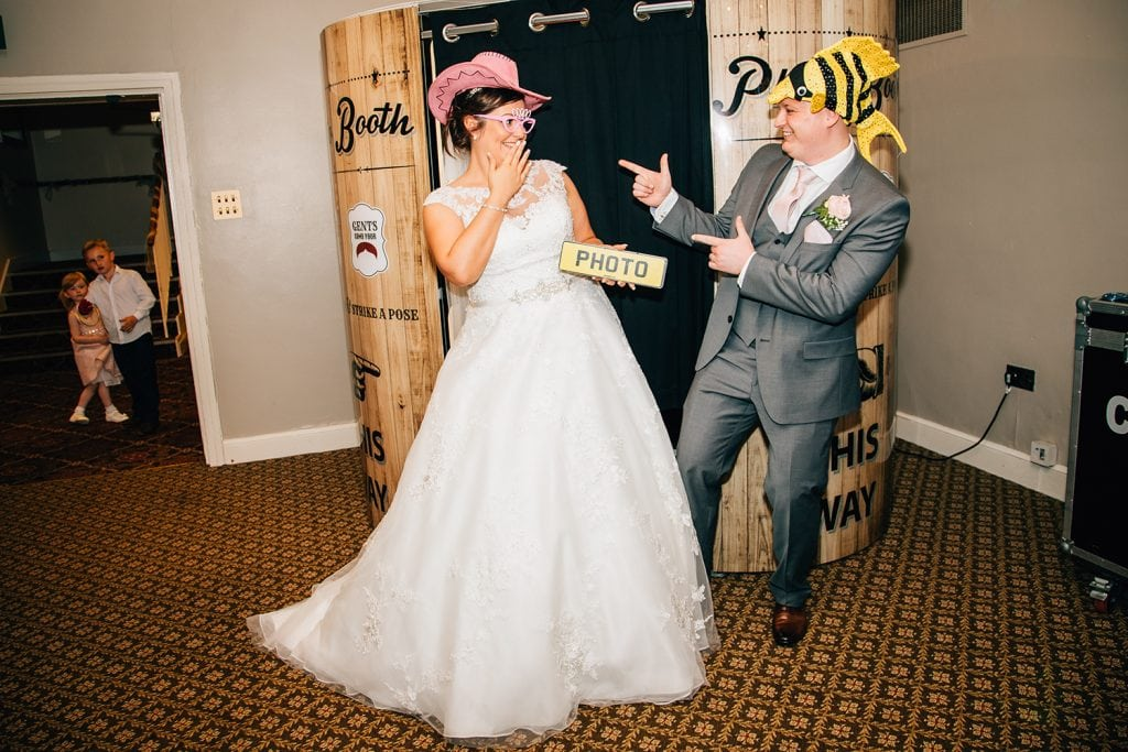 Bride & groom at craxy pix photo booth