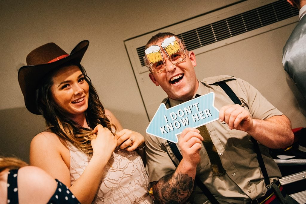Guests dressing up for the photo booth