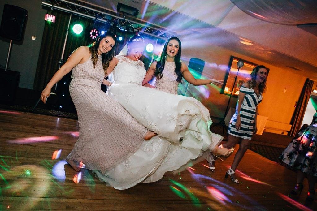 Bride dancing with her Bridesmaids