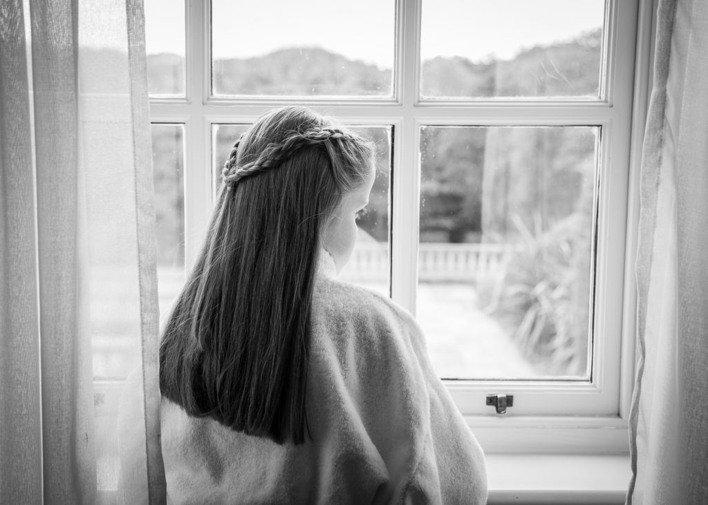 A Flowergirl looking out of a Seaham Hall window
