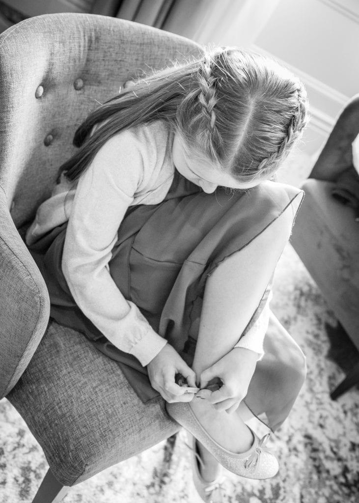 Flowergirl fastening her shoes