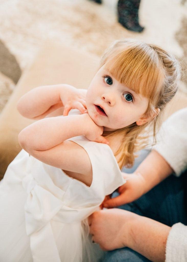 Little flower girl getting ready